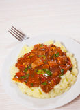 Meat in sauce with mashed potatoes Royalty Free Stock Photography