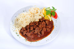 Meat with sauce and noodles. With shredded cheese Royalty Free Stock Image