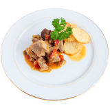 Meat sauce with potatoes. Beef with pepper sauce onion parsley garlic sauce and chips cut and isolated with path Stock Photography