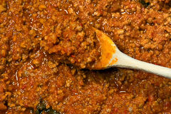 Meat Sauce with Wooden Spoon Stock Image