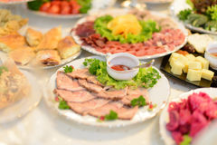 Meat with Saucer. Plate with meat and saucer on table Stock Photo