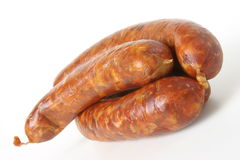 Meat-sausage. Assortiment of sausages. Meat on the white background Royalty Free Stock Photography