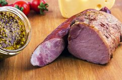 Meat, sausage, cheese with french mustard royalty free stock images