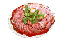 Meat and sausage cutting. Meat foodstuff on a plate Stock Photo