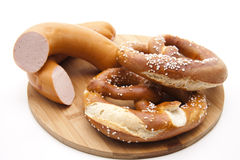Meat sausage with salt pretzel Royalty Free Stock Photos