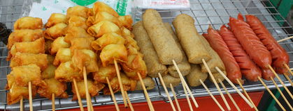 Meat and sausage skewers at a street stall. In Bangkok, Thailand Stock Photo
