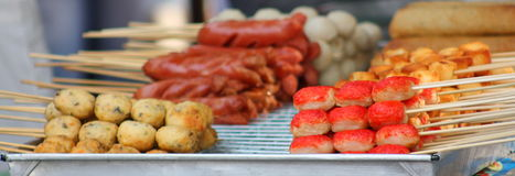 Meat and sausage skewers at a street stall. In Bangkok, Thailand Royalty Free Stock Photography
