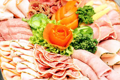 Meat sausage slices assortment on Party Plate Stock Image