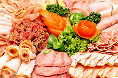 Meat sausage slices assortment on Party Plate Stock Photography