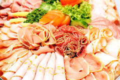 Meat sausage slices assortment on Party Plate Stock Photos