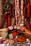 Meat and sausages. All sorts of meat isolated on light background stock photography