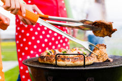 Meat and sausages on BBQ grill Royalty Free Stock Photos