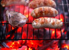 Meat and sausages on BBQ. Stock Image
