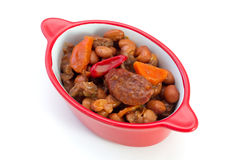 Meat with sausages and beans Stock Images