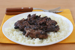 Meat with sausages and beans on rice Stock Photos