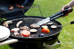 Meat and sausages on grill Royalty Free Stock Photos
