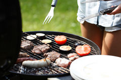 Meat and sausages on grill Royalty Free Stock Images