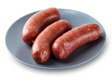 Meat sausages on a plate. Isolated on a white background Royalty Free Stock Photography