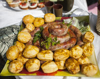 Meat sausages with potatoes Stock Photos