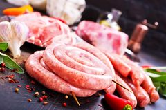 Meat and sausages. Raw meat and sausages on a table, stock photo Stock Photos