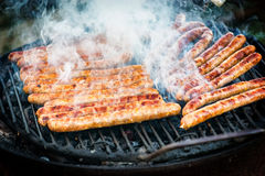 Meat sausages roasted on the grill Stock Image