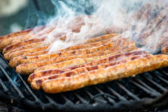 Meat sausages roasted on the grill Royalty Free Stock Photography