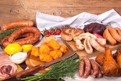 Meat and sausages Set of fresh and prepared meat. Beef, pork, salted lard and bologna and salami sausages Royalty Free Stock Photos