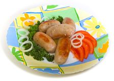 Meat sausages and tomato Stock Image