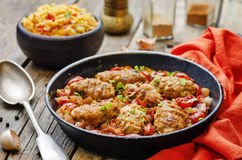Meat sausages with tomatoes Royalty Free Stock Photos