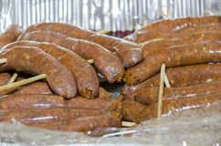 Meat sausages on wooden skewers Royalty Free Stock Photography
