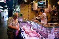 Meat seller   La Boqueria Market in Barcelona, Spain Royalty Free Stock Image