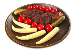 Meat served with baby corns Stock Image