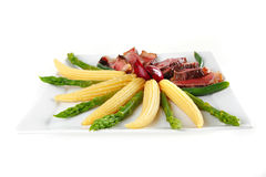 Meat served on white with corns Royalty Free Stock Photos
