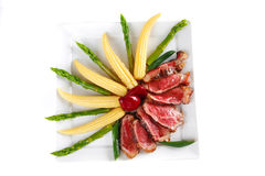 Meat served on white with corns Royalty Free Stock Photography