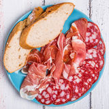 Meat set with baguette slices Stock Photography