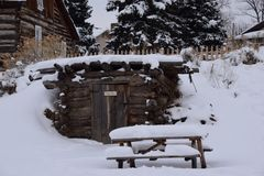 Meat shelter. Covered in snow picnic table trees wood lumber stock photo