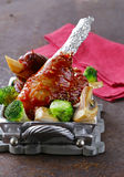 Meat shin baked with tomato sauce with vegetables Stock Photography