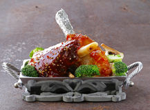 Meat shin baked with tomato sauce with vegetables Royalty Free Stock Image