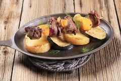 Meat skewer with baked potatoes Royalty Free Stock Image