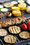 Meat skewer on grill Stock Photos