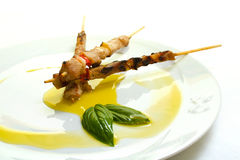 Meat skewer with olive oil garnish Royalty Free Stock Photo