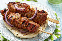 Meat skewer on pita bread Royalty Free Stock Images