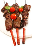Meat on skewer with tomatoes Royalty Free Stock Image