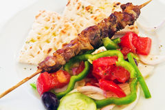 Meat skewer with vegetables and  pita bread Royalty Free Stock Image