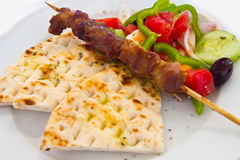 Meat skewer with vegetables and  pita bread Stock Photography
