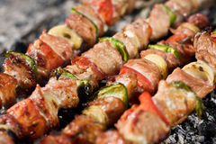 Meat skewers. Barbecue with delicious grilled meat on grill More skewers here stock photo