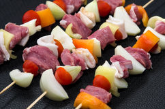 Meat skewers in frying pan Royalty Free Stock Photography
