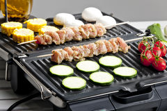 Meat skewers on grill Stock Images