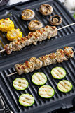 Meat skewers on grill Stock Photo