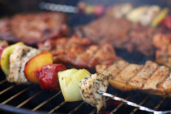 Meat and skewers on the grill Stock Photography